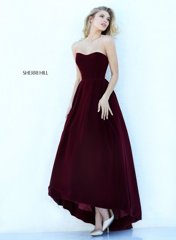 Sherri Hill 50735 is a strapless long evening dress with a subtle high-low hemline and a full skirt.