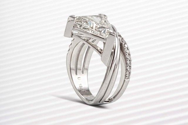 5.02ct Trilliant cut diamond ring - with small diamonds.