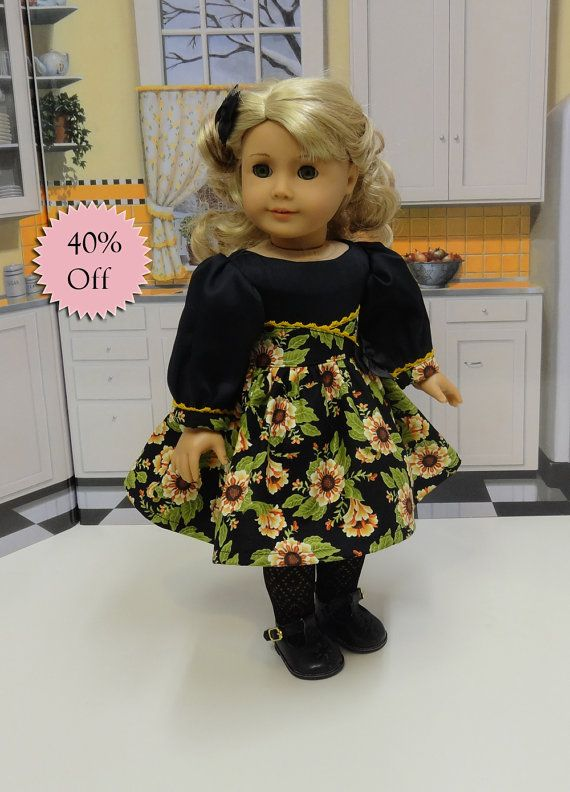 Originally $47, now $28.20  This lovely retro style dress is made of a beautiful marigold flourished flower print on black cotton. The bodice has