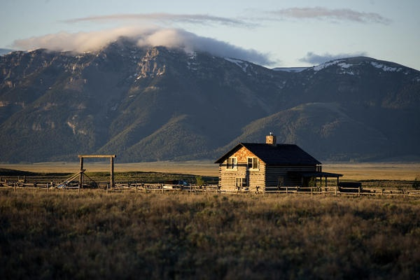 Green Ranching - A guest house at the J Bar L Ranch at dawn on June 20, 2012 in the Centennial Valley, Montana. The J Bar L is also a guest ranch, offering visitors a chance to herd cattle and learn about the holistic approach-The Christian Science Monitor - CSMonitor.com