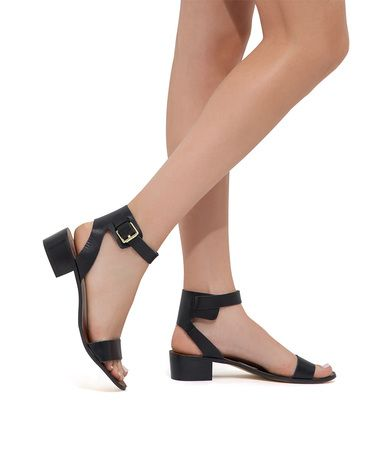 The refined design of this low heel sandal offers bold style with a cuff-like ankle strap.