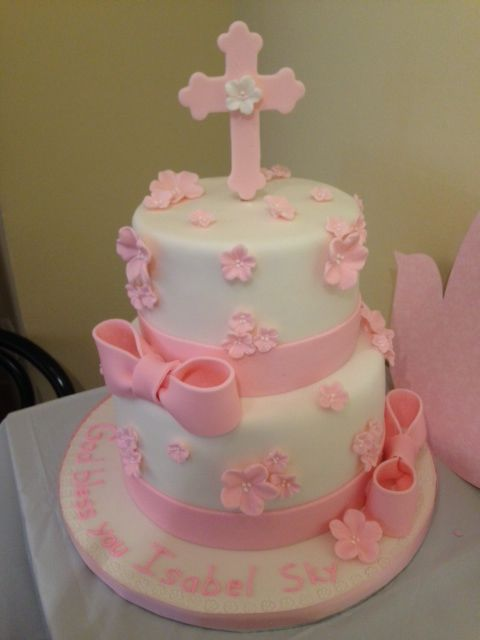 Girls baptism cake with bows and flowers