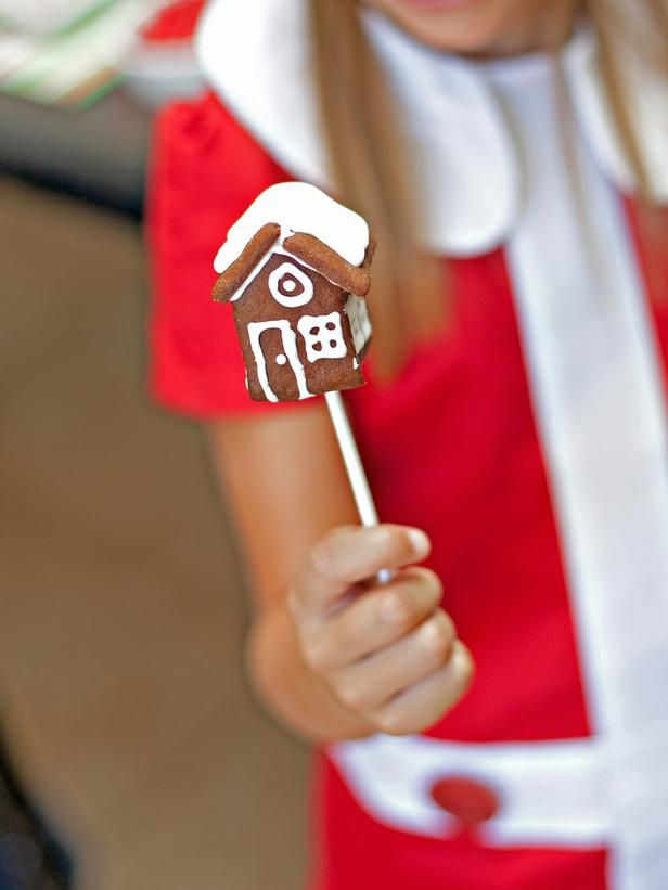 gingerbread house pops. piece together mini gingerbread houses with royal icing.  stick a marshmallow on the stick before inserting it into the mini house.