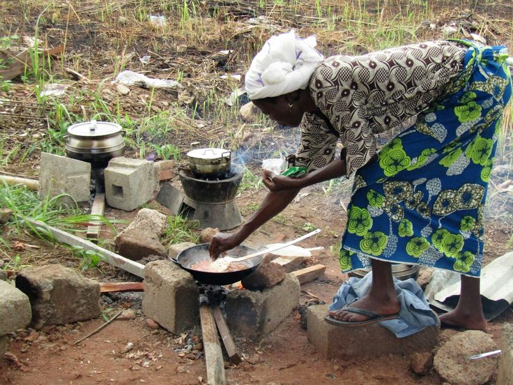 African woman cooking. BENIN