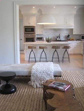 Julie Hillman Design | Love the white light over the counter, marble backsplash, stools, coffee table, throw and rug.