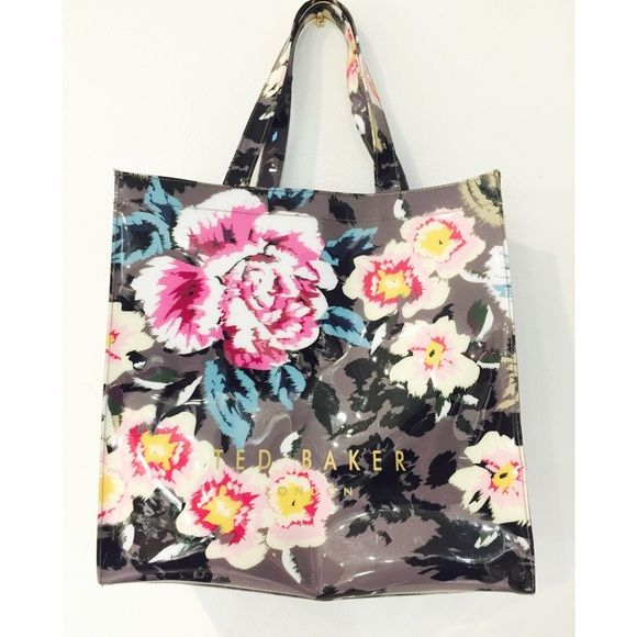 new | Ted Baker Signature Ted Baker tote in charcoal grey with vibrant floral print. Purchased in London trip at Ted Baker London boutique. Interior zip pick. Interior extremely clean actually no signs of wear. One handle need a stitch repair that can be done at a shoe cobbler. Price reflects cost of repair. In overall excellent condition. Great bag for the beach!$48 Ted Baker Bags Totes