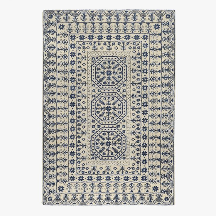 Inspired by global motifs and a versatile blue and beige color palette, our Indigo Sanskrit Wool Rug is a modern take on traditional textiles.