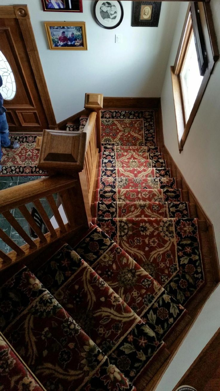 Traditional patterned carpet runner installed by Riemer