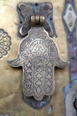 One theory postulates a connection between the khamsa and the Mano Pantea (or Hand-of-the-All-Goddess), an amulet known to ancient Egyptians as the Two Fingers. In this amulet, the Two Fingers represent Isis and Osiris and the thumb, their child Horus and it was used to invoke the protective spirits of parents over their child.[The hand of Fatima brings good luck and wards off the evil eye.