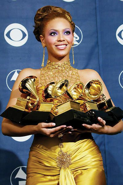 Beyonce won 5 awards at the 46th grammy awards in 2004, becoming the 4th female artist to win 5 trophies