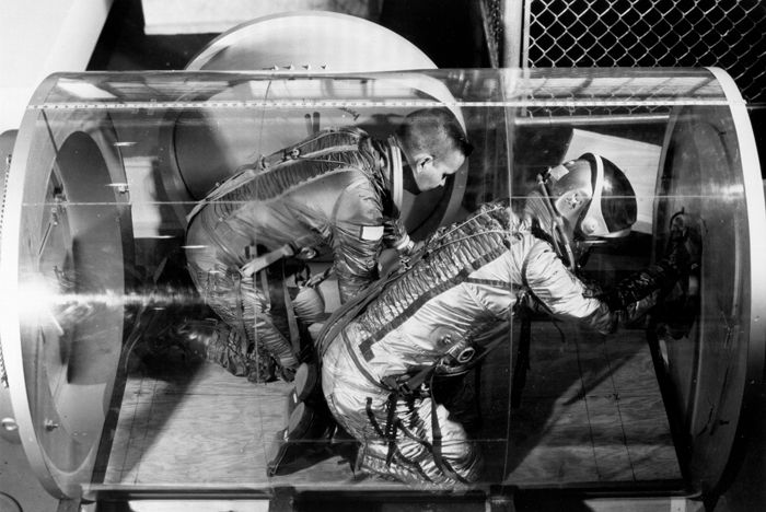 Space History Photo: NASA's Langley Research Center scientists use this plexiglass space station airlock test model to determine astronauts' ability to move in and out through an airlock with the restraint of a pressurized suit.