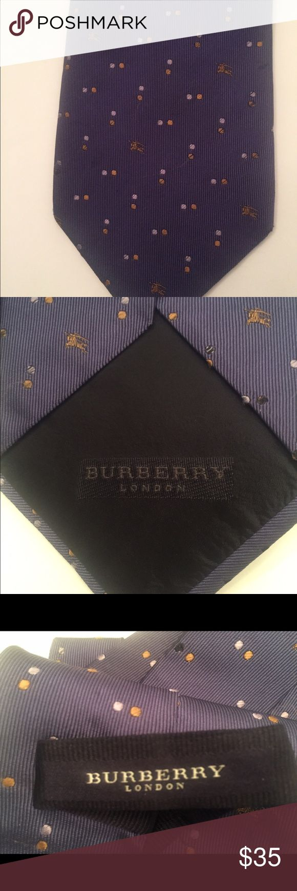 """Men's Burberry London 100% Blue Tie This is a 100% silk blue Burberry London tie with a polka dot and Burberry horse logo pattern.  The length is 57"""" and the width is 4"""".  The color is not a true blue but can best be described as a bluish- purple (trust me -  no one would call this tie purple but doing my best to describe the color!!). :-) Burberry Accessories Ties"""