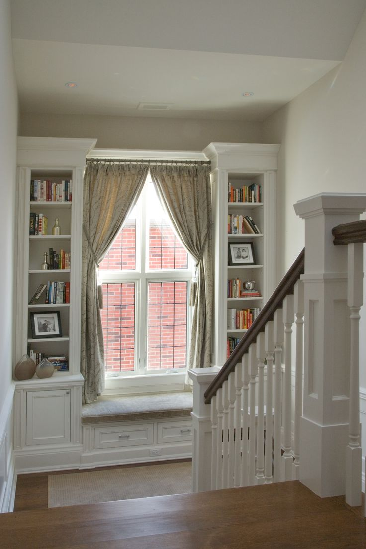 Charming reading nook! Staircase landing with a built-in window seat designed by CMID www.cmidesign.ca #CMID