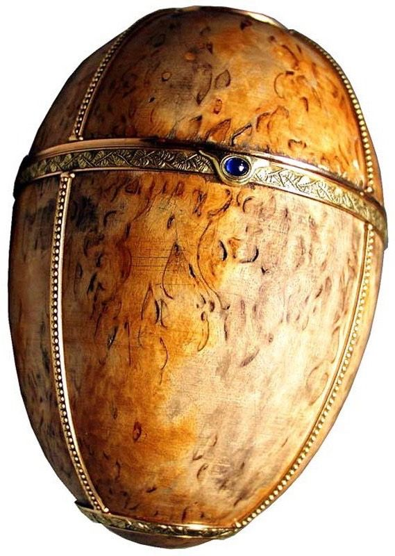 Imperial Karelian Birch Egg, Russia (1917; made by the House of Fabergé; Karelian birch, gold, sapphire, diamonds). Intended gift of Emperor Nicholas II to mother and Dowager Empress Maria Feodorovna. Due to the February Revolution and Nicholas' abdication, Maria Feodorovna never received the Easter egg. It is the only egg that uses an organic material (wood) as it's primary element and is less ornate than previous eggs. This was due to austerity measures brought on by World War I.