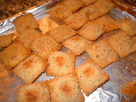 Oven Toasted Ravioli -I used leftover cooked ravioli-had to bake quite a while longer than the recipe to crisp but still yummy with pizza sauce--js