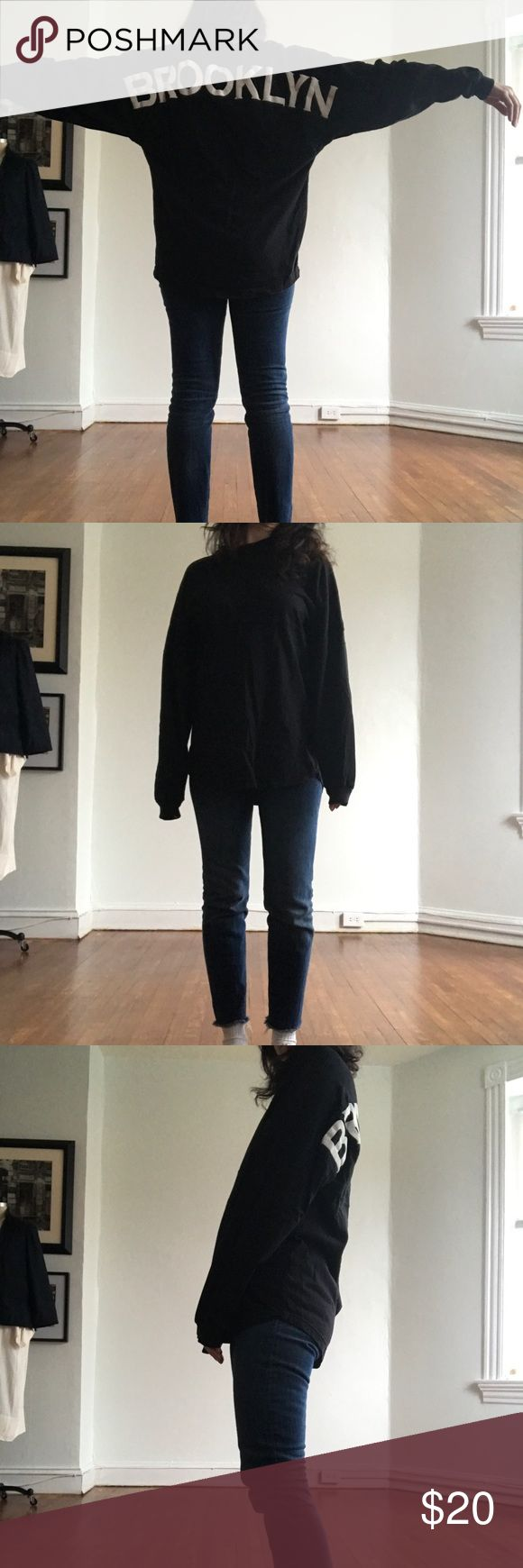 "Oversized black long sleeve top Fun oversized long sleeve top. Purchased at famous Patricia Fields store in NYC. Back graphic is white puffy in that reads Brooklyn. Size small but it is oversized. I am 5'5"". Tops Tees - Long Sleeve"