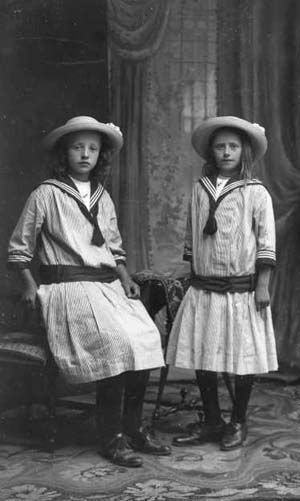 Two girls in sailor dresses.