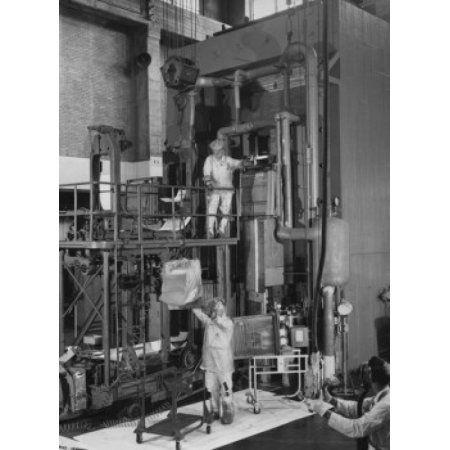 USA Tennessee Oak Ridge Oak Ridge National Laboratory three scientists working in nuclear laboratory Canvas Art - (24 x 36)
