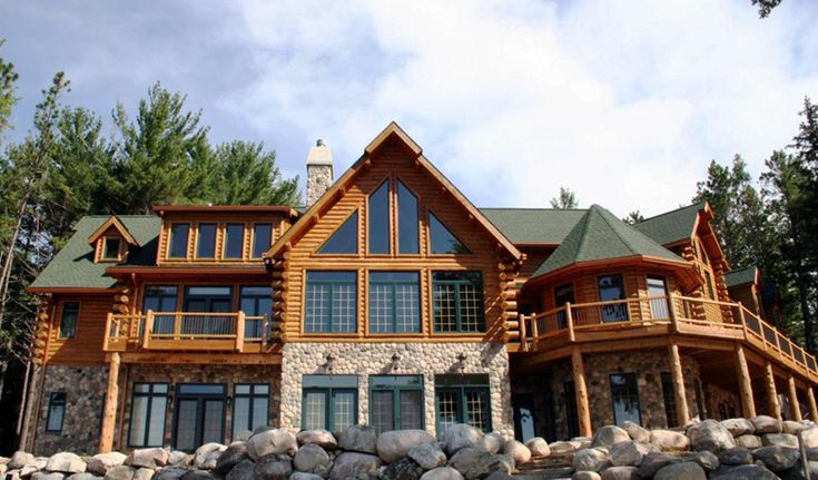 Designed by rapid river rustic inc half stone half log for Log and stone house plans