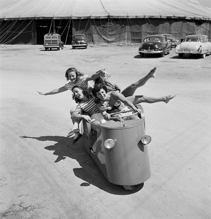 A group of circus girls taking a ride in a circus vehicle during a rehearsal for the Ringling Bros. and Barnum & Bailey Circus in Sarasota, FL in 1949.