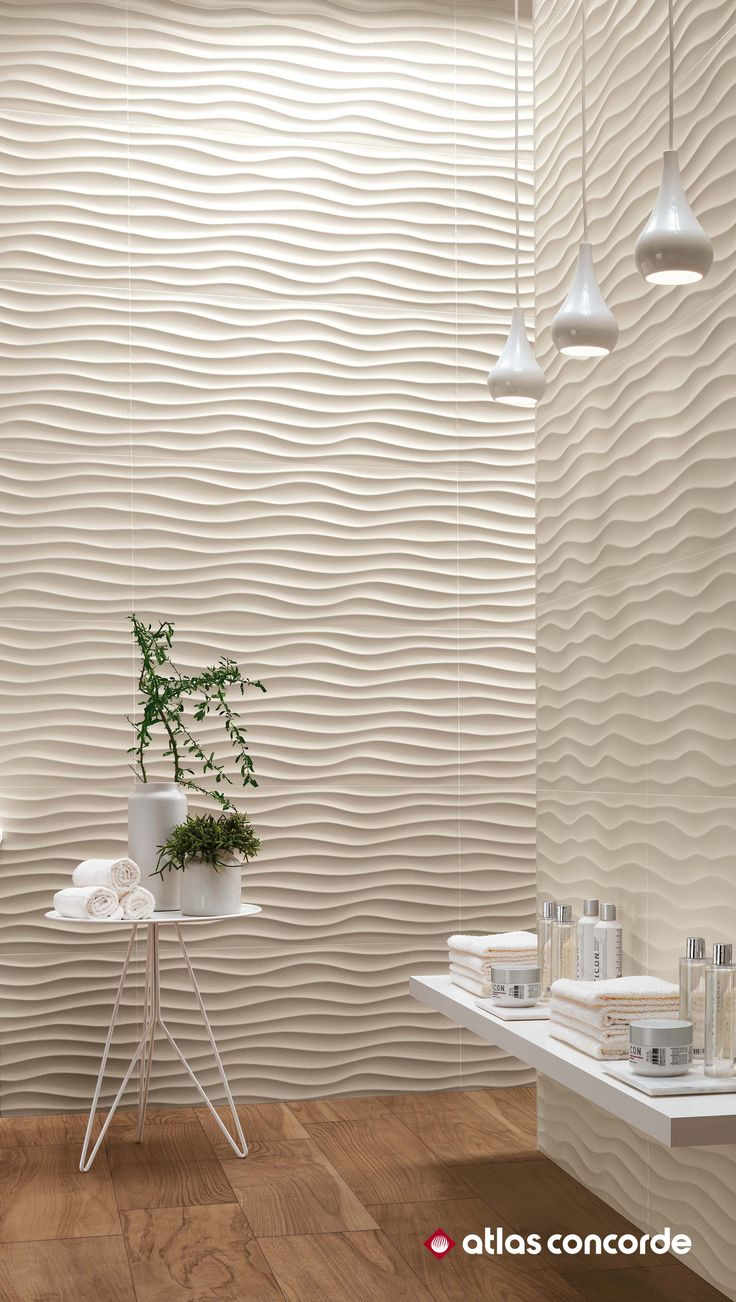 The walls of the wellness area evoke the warmth and the naturalness of sand dunes sculpted by the wind, becoming the unrivalled protagonists of a space dedicated to wellness and relaxation. | 3D WALL DESIGN | atlasconcorde.com