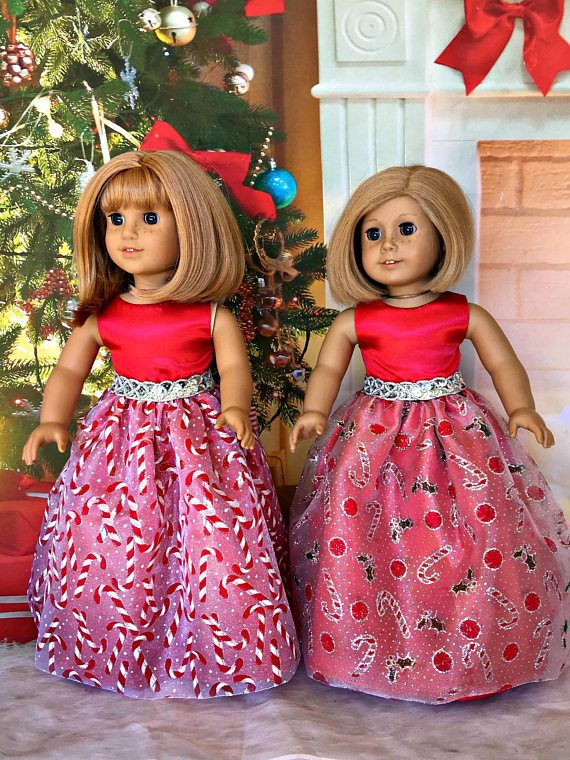 American Girl Christmas Formal - AG Christmas gown - fits the American Girl and similar 18 inch dolls. Nellie and Kit are ready to attend the Christmas Ball or even dance in the Nutcracker. This elegant evening gown has a fully lined, sleeveless bodice made from red satin. The