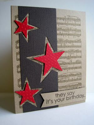 handmade birthday card ... kraft base ... music score stamped on ... wide column in black/darkest brown with large stars punched/die cut going off the edge ... slightly smaller die cut red stars popped up and placed in the negative space ... luv this card!!!
