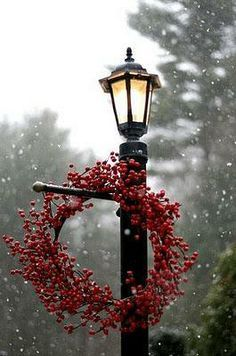 Christmas light post with red wreath.