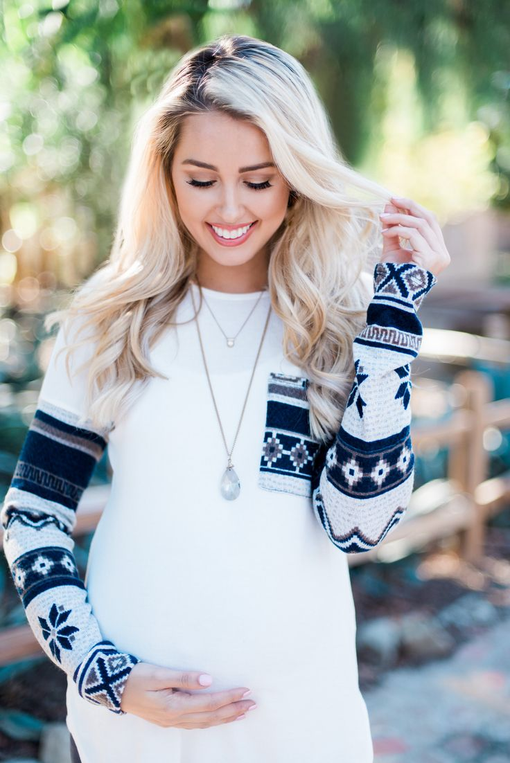 We are absolutely loving this snowflake sleeve maternity top! Just in time for the holidays and winter season, you can wear this top with a scarf and maternity jeans for a complete look that will keep you warm day and night.