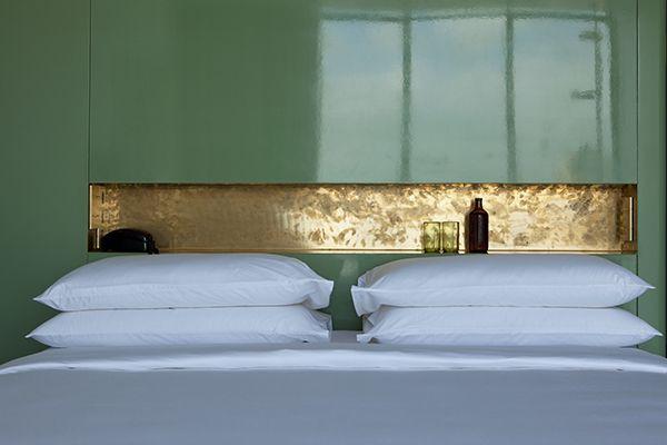 brass shelf as headboard, Casa Fayette, by Studio Dimore