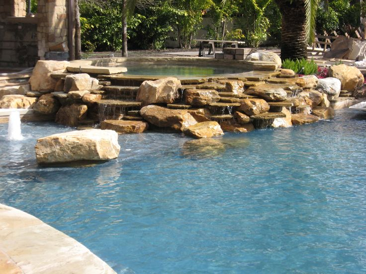 17 best images about natural stone hot tubs on pinterest for Stone swimming pool