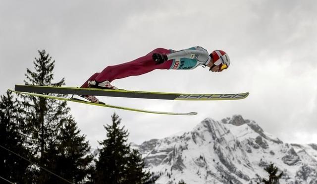 Poland's Kamil Stoch mid-jump.