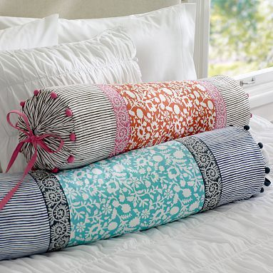 creative fab india bolster pillow covers in pretty red or aqua blue with ribbon trim