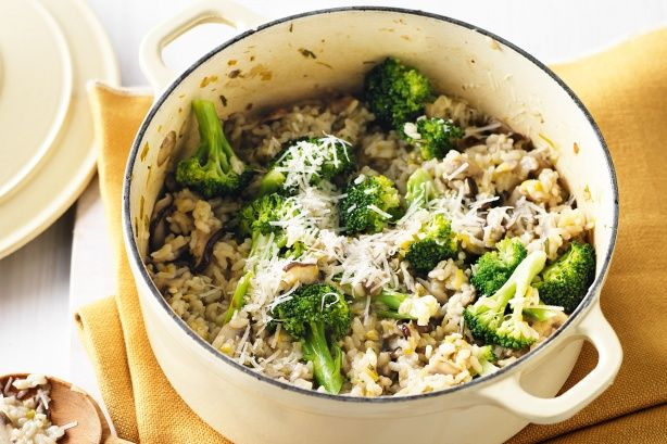 Oven-baked mushroom risotto - 2 tsp olive oil  1 large leek, trimmed, thinly sliced  400g mixed mushrooms (such as Swiss brown, button and shiitake), sliced  2 garlic cloves, crushed  2 tsp chopped fresh rosemary  250g arborio rice  80ml (1/3 cup) white wine  750ml (3 cups) salt-reduced vegetable or chicken stock  250g broccoli, trimmed, cut into florets  20g (1/4 cup) finely grated parmesan, plus extra to serve