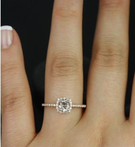 Rose gold morganite engagement ring with diamond halo, $650. This diamond alternative looks classic and fashionable, sans the hefty price tag. | Budget Friendly Engagement Rings Under $1000