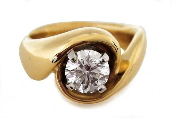 """""""Large Swirl"""" 18k yellow gold with diamond by Hanna Cook-Wallace."""