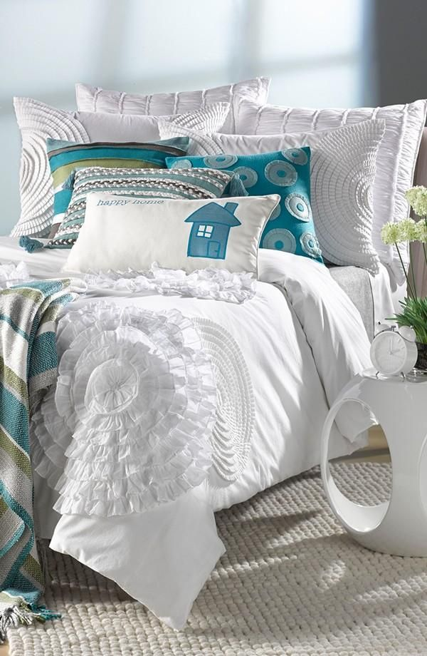 Beautiful bedding with the perfect blend of blue and white textures.