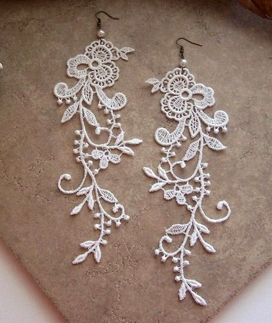 Pretty lace earrings - cut out lace section from scraps of material, prevent frays by lightly painting with fabric glue (will also give the lace body), glue on any gems or sew on some pearls if desired, and finally attach the earring hook!