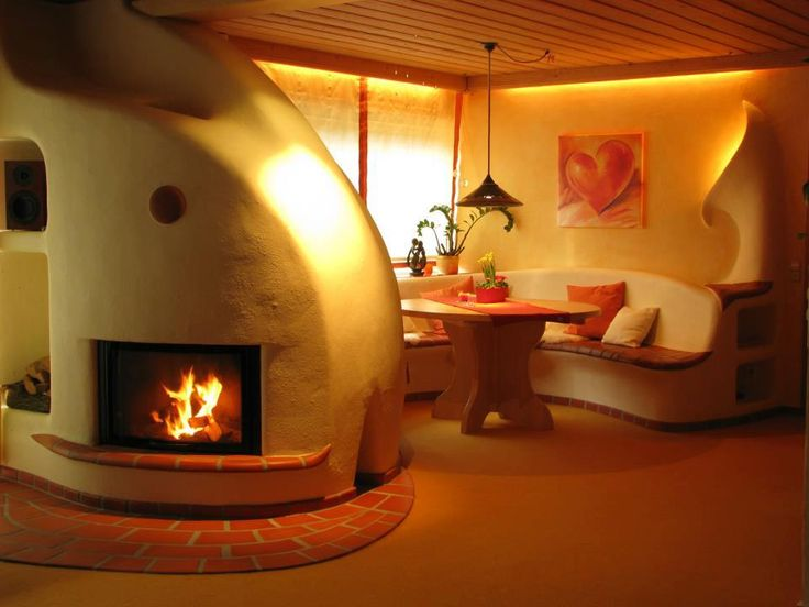 [ like the recessed lighting, thinking this is a rocket stove fire place and bench. Nice. ki ]