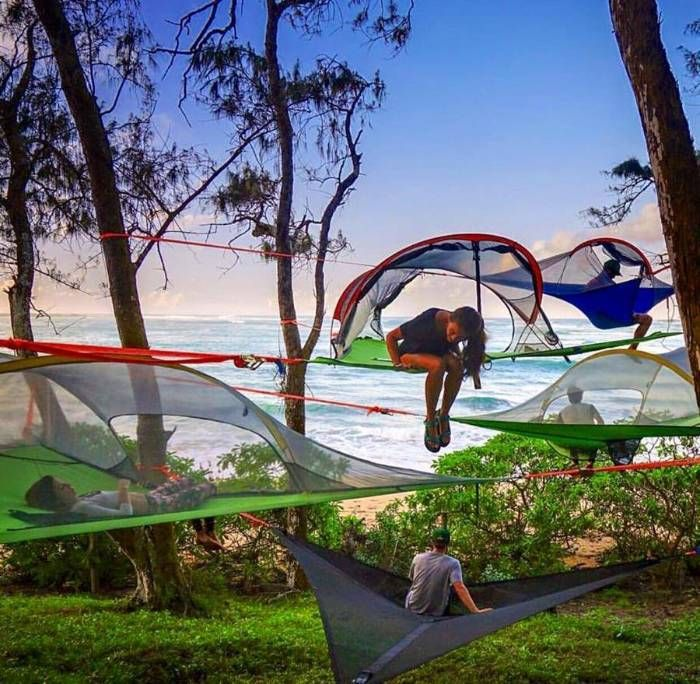 This is a cool way to do camping. They call this Hammock tent. Joust fix it on 3 trees and then you camp in the air how cool is that ?