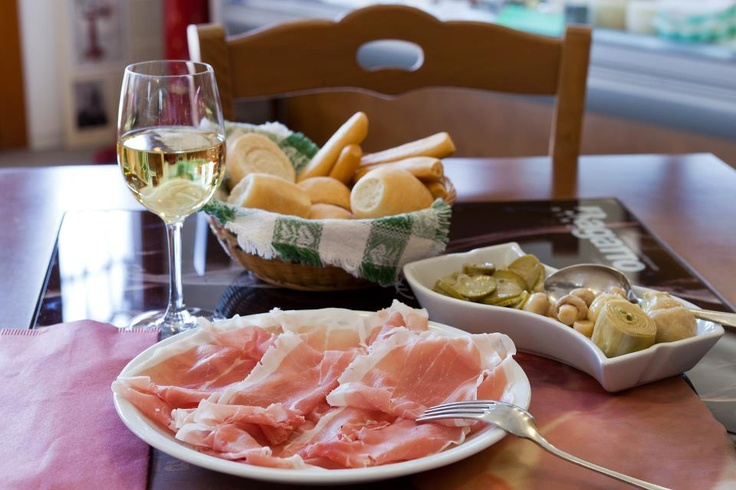 San Daniele row ham with Prosecco wine - typical food of Friuli region