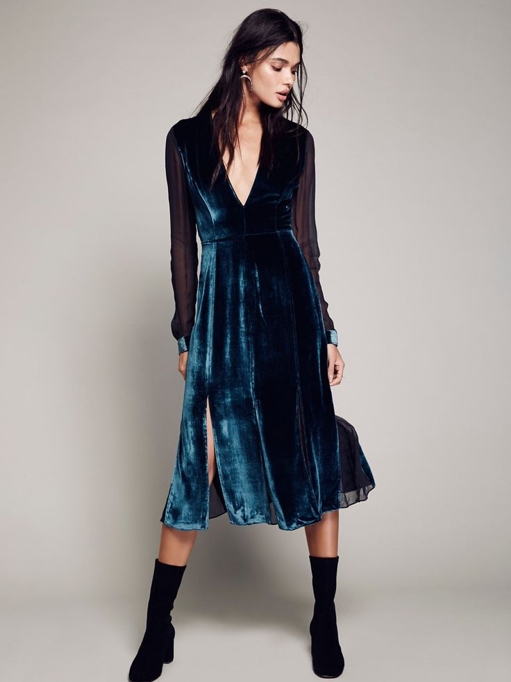Amelina Velvet Dress | In a luxe velvet this midi dress features a plunging V-neckline pieced with sheer mesh on the back, long sleeves, and skirt. Hidden side zip closure.