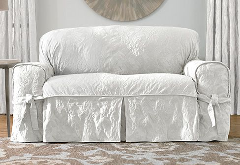 these will be my new slipcovers for my family room! matelasse damask slipcovers in white. $139.00 from surefit.