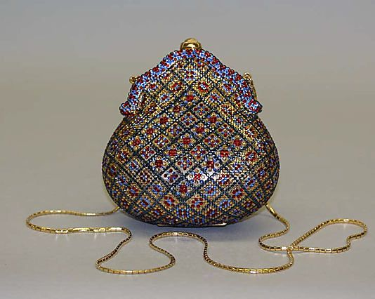 "Minaudière 1967 metal and leather 5 1/4-inch Evening purse by Judith Leiber. Label: ""Judith Leiber, N. Y."" via MMA."