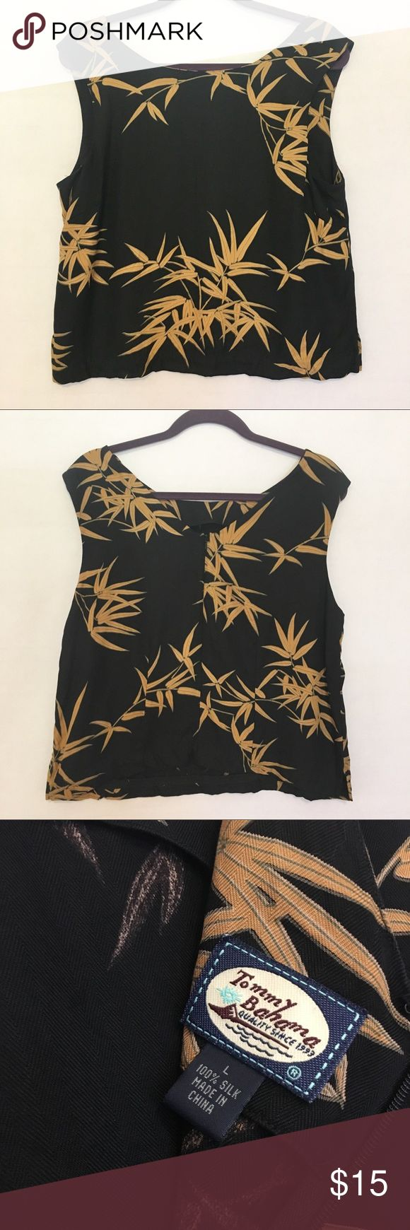 "Tommy Bahama silk leaf print blouse sz large Tommy Bahama Women's 100% silk Sleeveless blouse. Has a wide neckline and back zip up closure. Black with gold tropical leaf print. 20"" armpit to armpit and 22"" shoulder to hem. EUC. Tommy Bahama Tops Blouses"