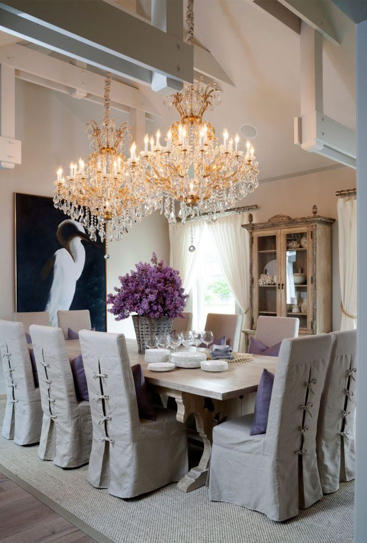 Cottage Style Dining Room Illuminated With Double Grand Crystal Chandelier Lights Over Concrete Dining Table Crystal Chandelier Lighting Offer Luxurious Feel Check more at http://www.wearefound.com/crystal-chandelier-lighting-offer-luxurious-feel/