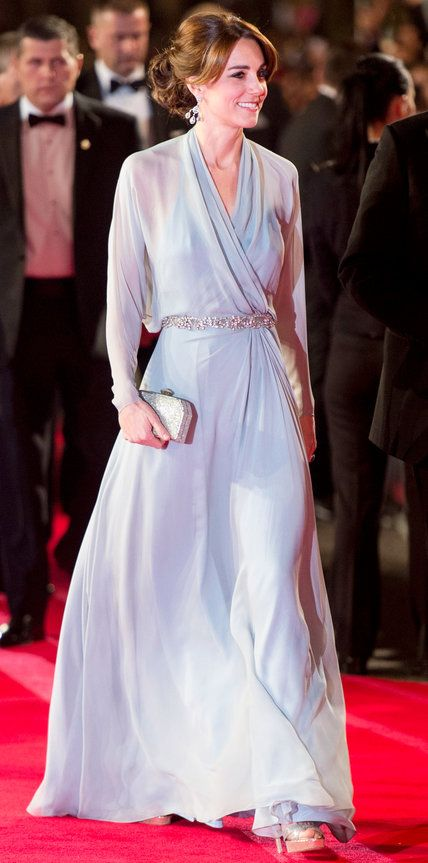 Kate Middleton channeled Elsa from Frozen, gracing the Spectre world premiere in an icy blue silk chiffon Jenny Packham with a crystal embellished belt and a silver box clutch. Chandelier earrings and metallic Jimmy Choos completed her look.