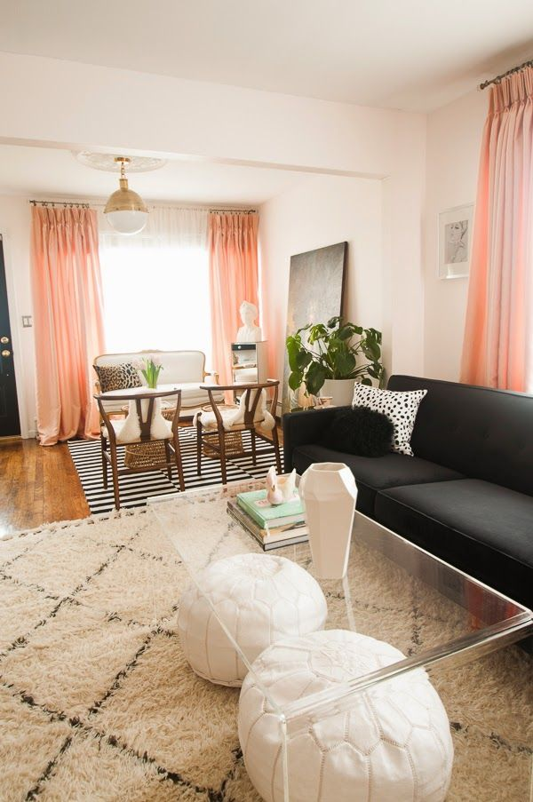 Peekaboo Coffee Table || Peachy pink floor to ceiling drapes add color in this otherwise neutral living space. black, white, pink, and leopard with accents of lucite and gold. glamorous and feminine and pretty.