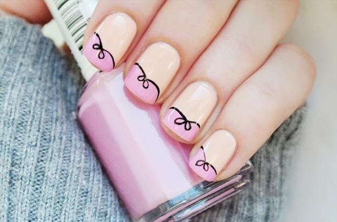 Cutesy french manicure ribbon design---kinda reminds me of a Paris cartoon design?