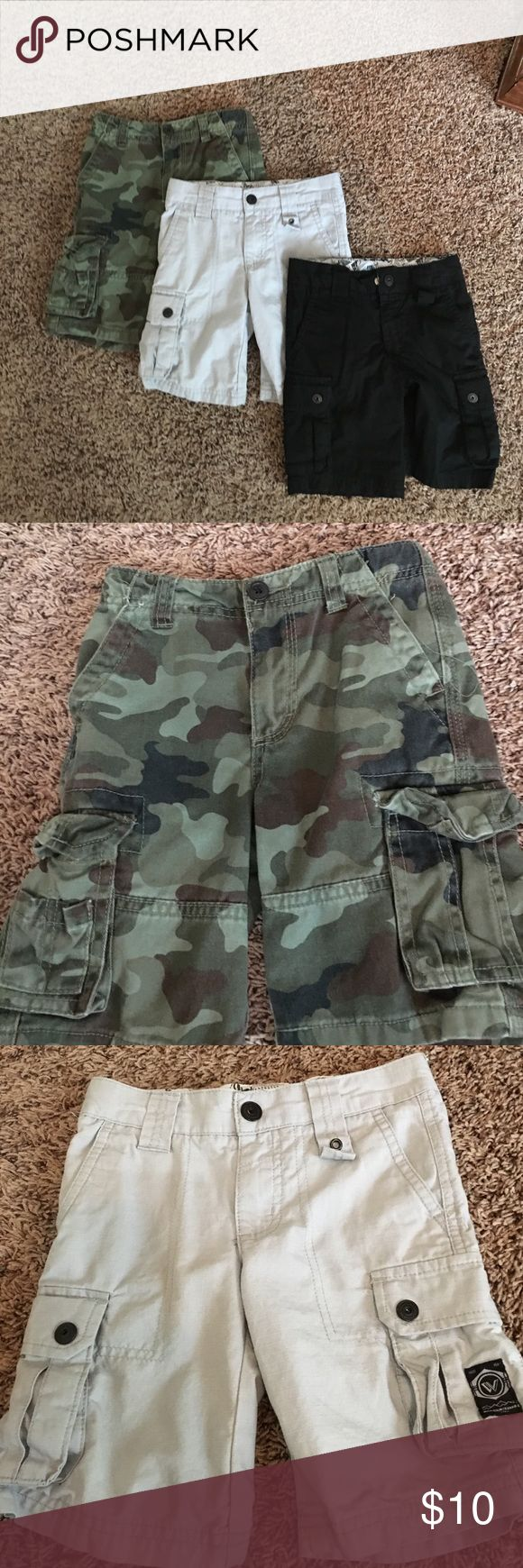 3 pairs of Shawn white boys cargo shorts Shawn white green camo cargo shorts, Shawn white gray cargo shorts, Shawn white black cargo shorts. All size 4 boys. Good condition, each pair worn once. shawn white Bottoms Shorts